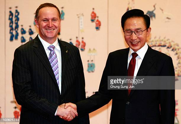 New Zealand Prime Minister John Key shakes hands with South Korean President Lee MyungBak before their meeting at the presidential house on July 5...
