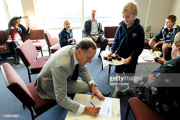 New Zealand Prime Minister John Key sketches during a visit to Cashmere Primary School on May 17 2012 in Christchurch New Zealand Prime Minister Key...