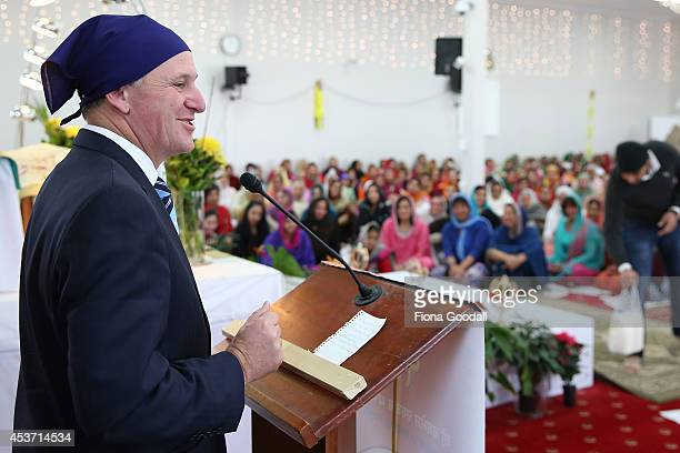New Zealand Prime Minister John Key speaks to the congregation during a visit to Sikh Temple 'Gurudwara Sri Dasmesh Darbar' in Papatoetoe on August...