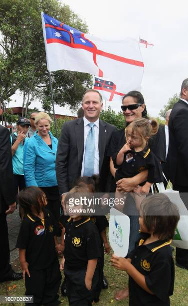 New Zealand Prime Minister John Key stops to pose with young children from Te Ohaki Te Kohanga Reo after visiting Te Tii Marae on February 5 2013 in...