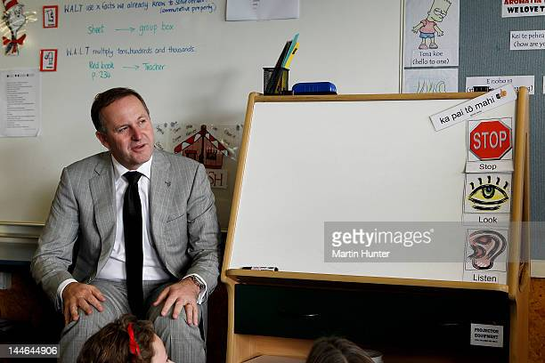 New Zealand Prime Minister John Key talks to children during a visit to Cashmere Primary School on May 17 2012 in Christchurch New Zealand Prime...
