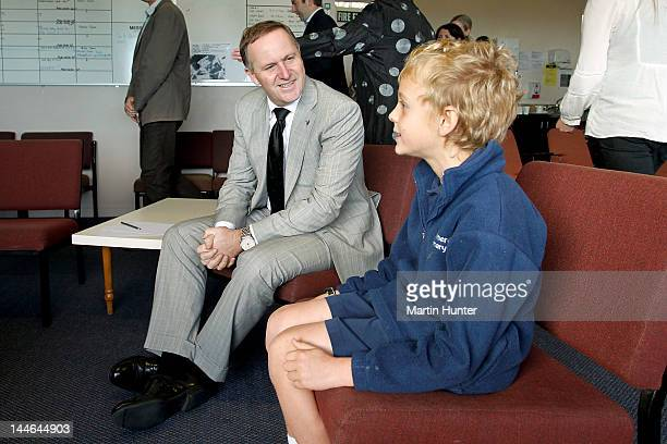 New Zealand Prime Minister John Key talks to Sam Willems during a visit to Cashmere Primary School on May 17 2012 in Christchurch New Zealand Prime...