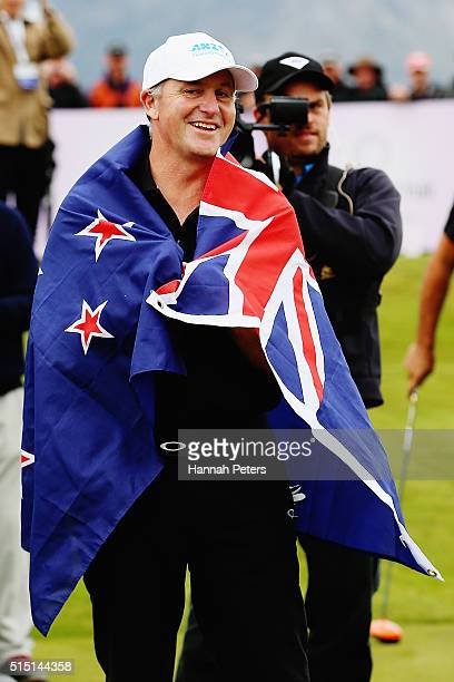 New Zealand Prime Minister John Key wears the New Zealand flag given to him by former Australian cricketer Ricky Ponting during day four of the 2016...