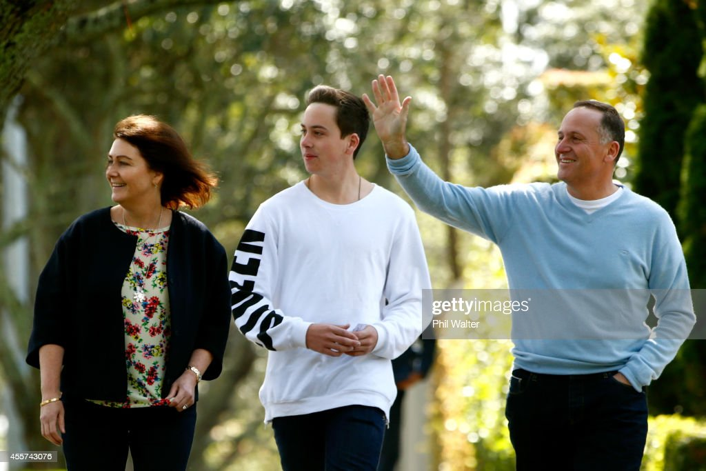 New Zealand Prime Minister John Key (R) with his wife Bronagh Key (L) and son Max Key (C) walk from their home to vote at the Parnell District School on September 20, 2014 in Auckland, New Zealand. Voters head to the polls today to elect the 51st parliament of New Zealand.
