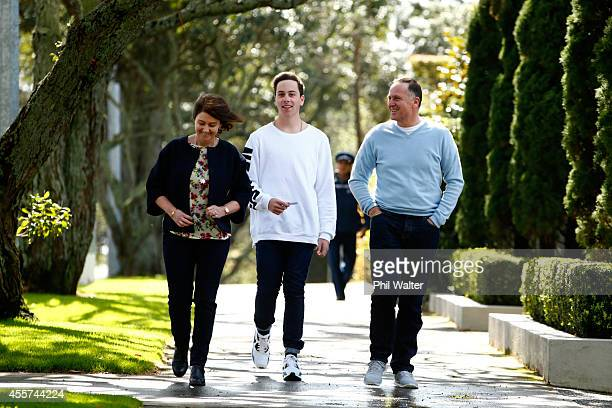 New Zealand Prime Minister John Key with his wife Bronagh Key and son Max Key walk from their home to vote at the Parnell District School on...