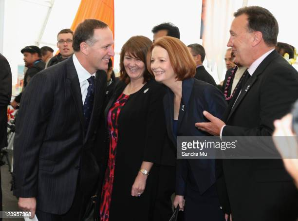 New Zealand Prime Minister John Key with his wife Bronagh Key explain the cultural activites to Australian Prime Minister Julia Gillard and her...