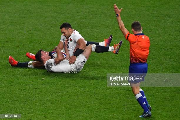 New Zealand referee Paul Williams indicates a try scored late on by England's George Ford during the Six Nations international rugby union match...