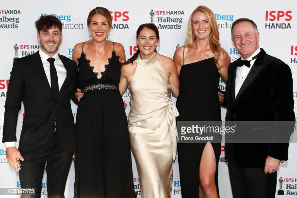 New Zealand rowers Kelsey Bevan Keri Dowler and Grace Prendergast with former New Zealand Prime Minister Sir John Key and his son Max Key arrive on...