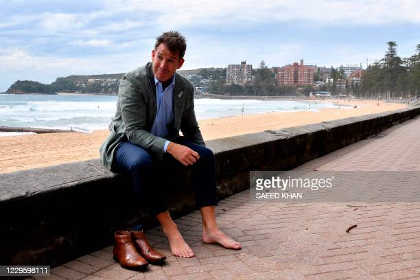 New Zealand Rugby chief executive Mark Robinson gets ready for a walk on Manly Beach after a press conference in Sydney on November 13 announcing...