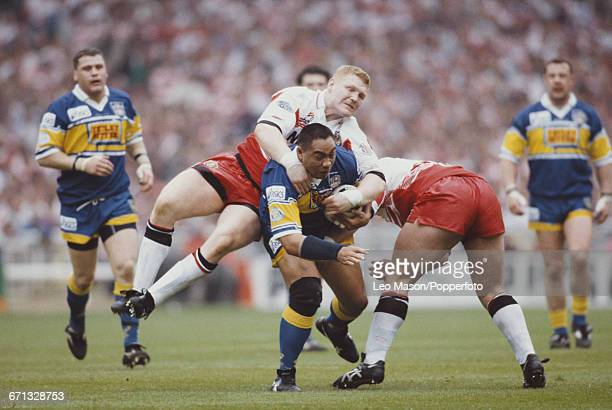 New Zealand rugby league player Esene Faimalo of Leeds is tackled by Neil Cowie of Wigan as he advances with the ball during the final of the 1995...
