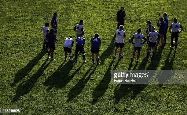 New Zealand Rugby Sevens coach Gordon Tietjens talks to players during a New Zealand All Blacks training session at Rugby League Park on July 6, 2011...
