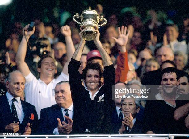 New Zealand rugby union captain David Kirk raises the Webb Ellis trophy after winning the Rugby World Cup by defeating France 299 in the Final at...