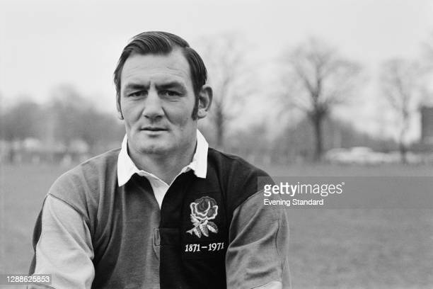 New Zealand rugby union player Brian Lochore in the UK to celebrate the Centenary of the Rugby Football Union, 7th April 1971. He is wearing the red...