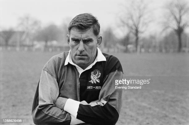 New Zealand rugby union player Colin Meads in the UK to celebrate the Centenary of the Rugby Football Union, 7th April 1971. He is wearing the red...