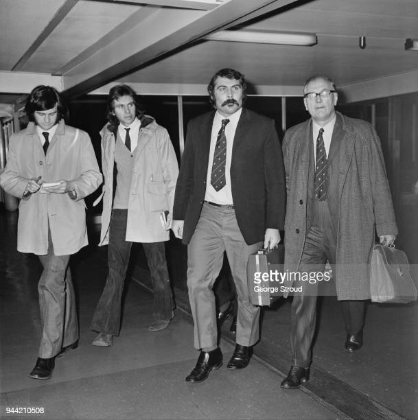 New Zealand rugby union player Keith Murdoch of the All Blacks New Zealand national rugby union team, pictured third from left in London as he leaves...