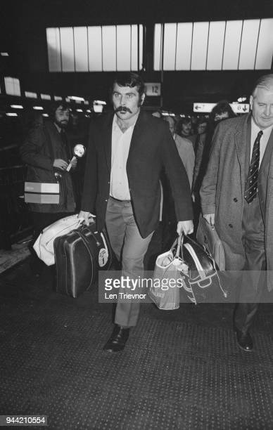 New Zealand rugby union player Keith Murdoch of the All Blacks New Zealand national rugby union team, pictured at Euston Station in London as he...
