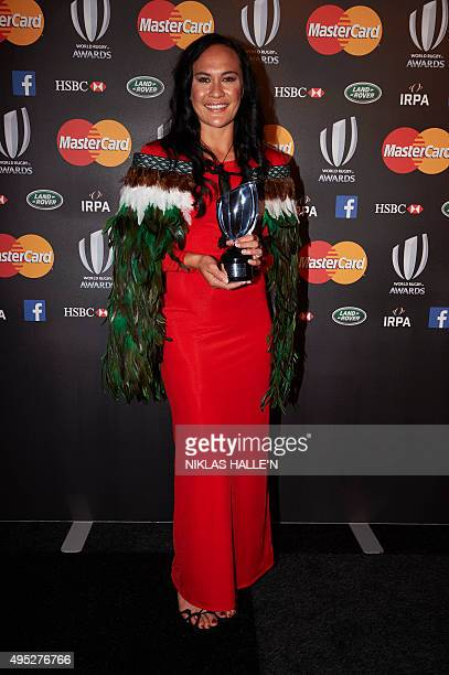 New Zealand rugby union player Portia Woodman poses for photographers after winning the Women's Sevens player of the the year award at the World...