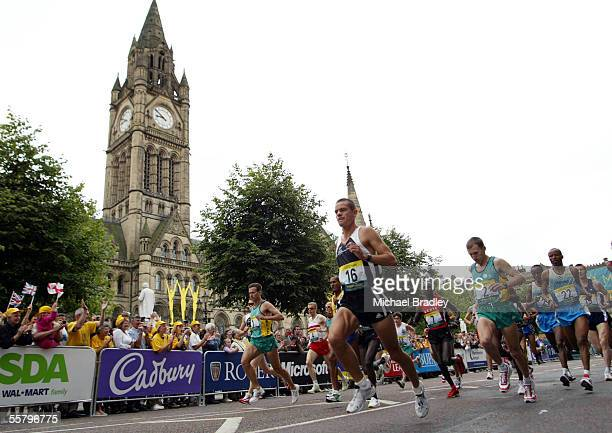 New Zealand runner Jonathan Wyatt passes the Mancester Town Hall at the start of the Mens Marathon at the XVII Commonwealth Games Sunday