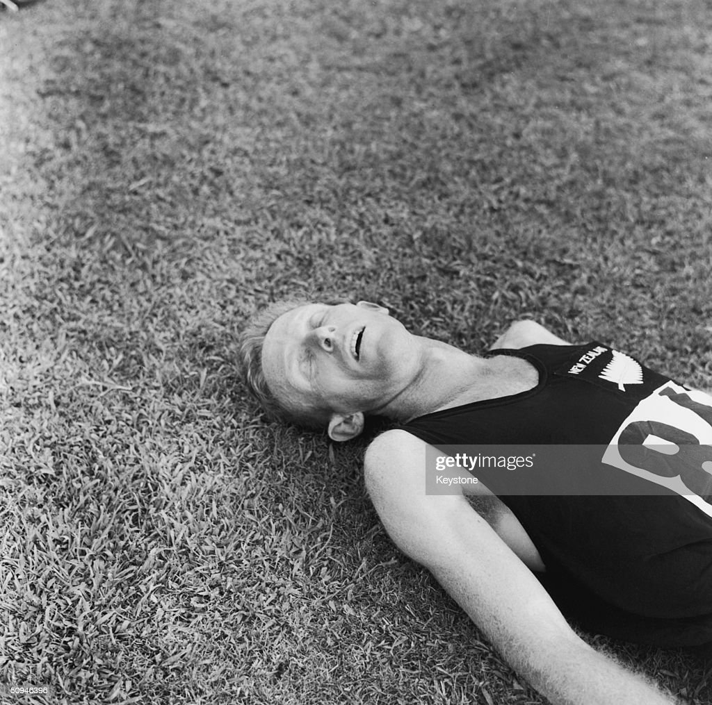New Zealand runner Murray Halberg lays exhausted after winning the 5,000 metres gold medal in the Rome Olympics, September 1960.