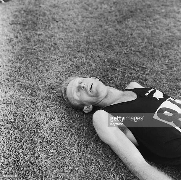 New Zealand runner Murray Halberg lays exhausted after winning the 5000 metres gold medal in the Rome Olympics September 1960