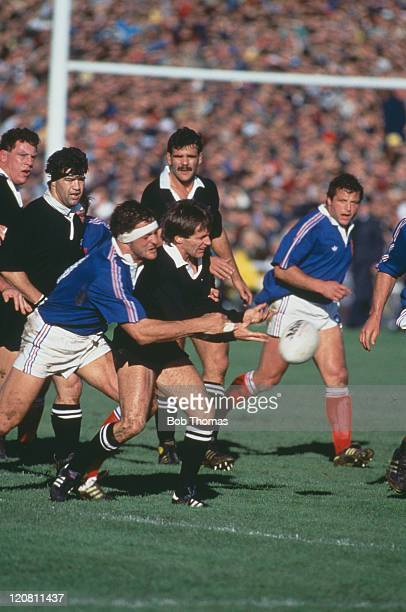 New Zealand scrumhalf David Kirk is challenged by France's Alain Lorieux during the Rugby Union World Cup Final in Auckland 20th June 1987 New...