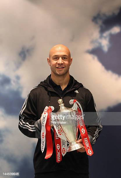 New Zealand Sevens captain DJ Forbes poses with the Sevens World Series Trophy upon their arrival home at Auckland International Airport on May 16...