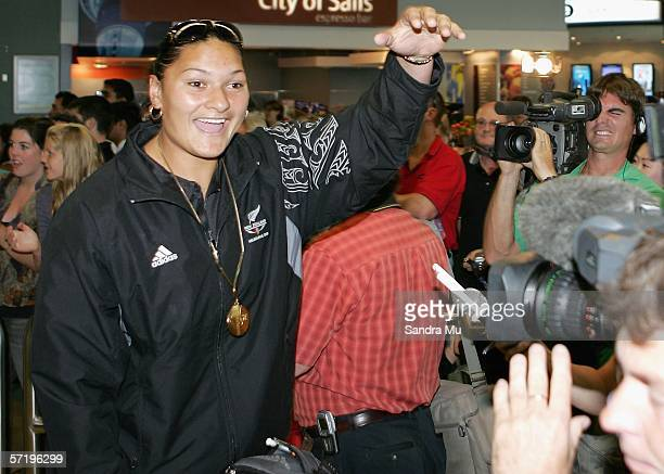 New Zealand shot putter Valerie Vili wearing her gold medal waves as she arrives home with the New Zealand athletes from the Commonwealth Games at...