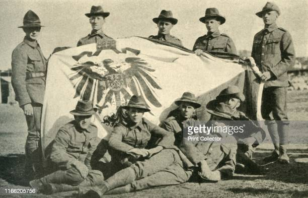 New Zealand soldiers with captured German flag First World War 'New Zealand's War Trophy Members of the Expeditionary Force with the German flag...