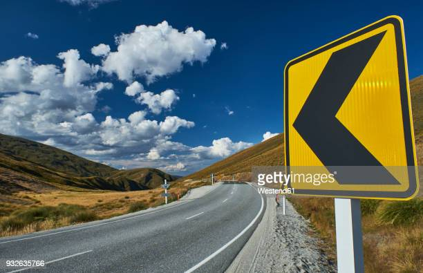new zealand, south island, crown range, crown range road - road sign stock pictures, royalty-free photos & images
