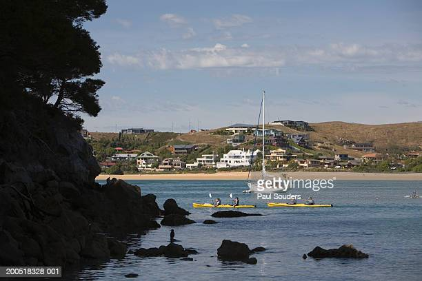 New Zealand, South Island, Kaiteriteri, sailboat and kayakers in sea