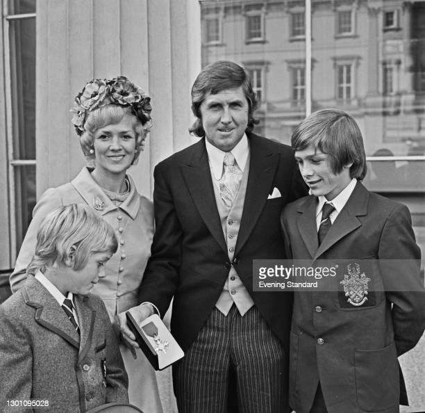 New Zealand speedway rider Barry Briggs receives an MBE at Buckingham Palace in London, UK, 24th October 1973. He is accompanied by his wife June and...