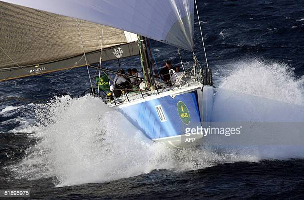 New Zealand super maxi Konica Minolta skippered by Stewart Thwaites leads the fleet down the east coast of Australia during the 60th Sydney to Hobart...