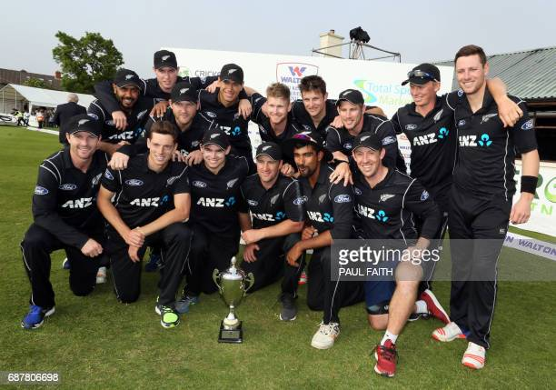 New Zealand team celebrate after winning the Ireland TriNation Series at Clontarf cricket ground in Dublin on May 24 2017 / AFP PHOTO / Paul FAITH