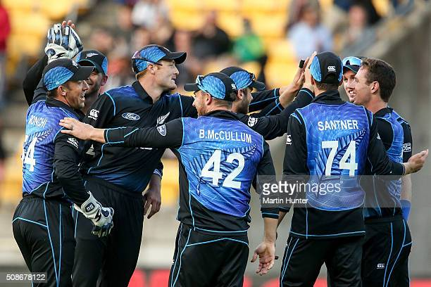 New Zealand team mates celebrate the wicket of Steve Smith of Australia during game two of the one day international series between New Zealand and...