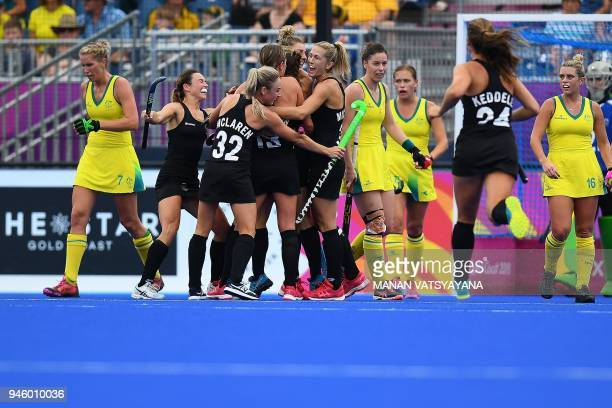 New Zealand team players celebrate a goal by teammate Shiloh Gloyn against Australia during their women's field hockey gold medal match of the 2018...