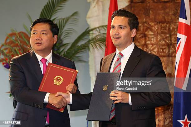 New Zealand Transport Minister Simon Bridges signs an air services agreement with Vietnam Minister of Transport Dinh La Thang as Vietnamese Prime...