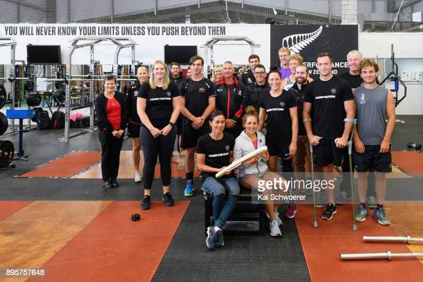 New Zealand triathlete Andrea Hewitt and New Zealand runner Rosa Flanagan pose with the Commonwealth Games Queen's baton and fellow athletes during a...
