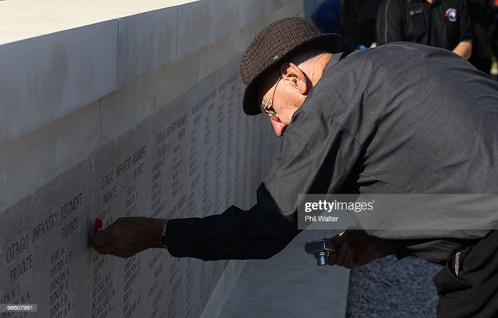 New Zealand war veteran Morris Johnstone pins a poppy next to the name of his uncle Private Roy Johnstone onto the memorial at Chunuk Bair honouring New Zealand soldiers killed in the First World War on April 22, 2010 in Gallipoli, Turkey. April 25 will commemorates the 95th anniversary of ANZAC (Australia New Zealand Army Corps) Day, when First World War troops landed on the Gallipoli Peninsula, Turkey early April 25, 1915. Today April 25 is commemorated with ceremonies of remembrance for those who fought and died in all wars.