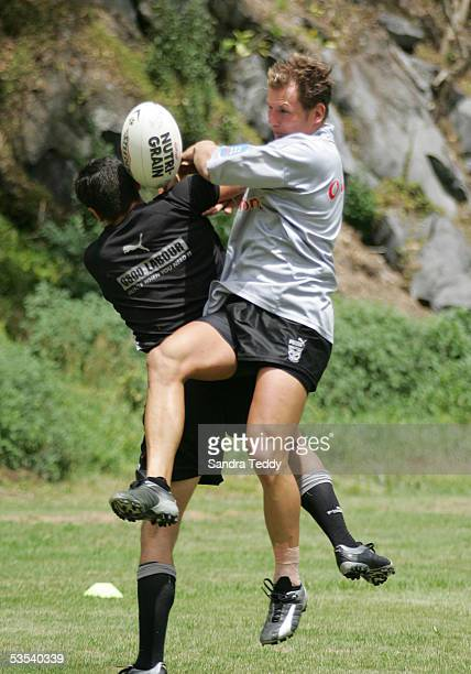 New Zealand Warriors Rowan Baxter jumps for the high ball during their training session at Auckland Grammar January 27 2005