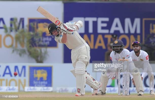 New Zealand wicket keeper batsman BJ Watling plays a shot as Sri Lankan wicketkeeper Niroshan Dickwella and Kusal Mendis look on during the third day...