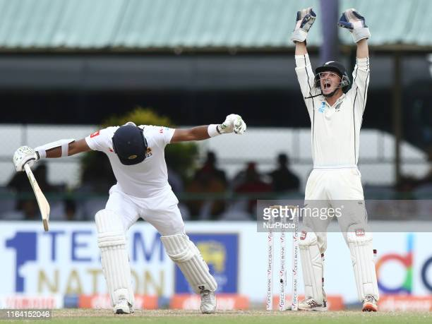New Zealand wicket keeper BJ Watling unsuccessfully appeals for the wicket of Sri Lankan cricket captain Dimuth Karunaratne during the fifth and...