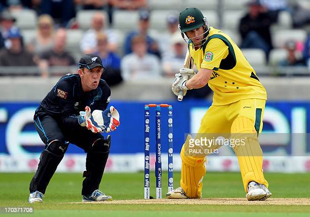 New Zealand wicket keeper Luke Ronchi watches a shot from Australia's Adam Voges during the 2013 ICC Champions Trophy One Day International cricket...