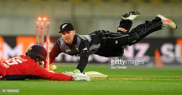 New Zealand wicketkeeper Tim Seifert runs out England batsman David Willey during the International Twenty20 match between New Zealand and England at...