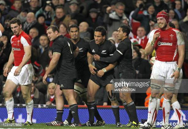New Zealand wing Hosea Gear celebrates scoring his second try with team-mates during the Autumn International rugby union match between Wales and New...