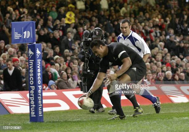 New Zealand wing Isaia Toeava scores his try during the Autumn International rugby union match between Wales and New Zealand at The Millennium...