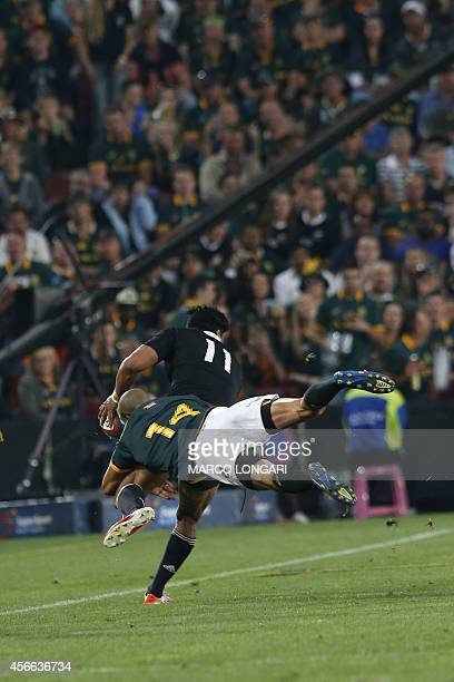 New Zealand wing Julian Savea is tackled by South African wing Cornal Hendricks during the final phase of the Four Nations tournament rugby union...