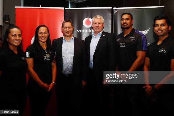 New Zealand womens rugby player Portia Woodman and All Blacks player Jerome Kaino pose for a photo with Vodafone Chief Executive Russell Stanners and...