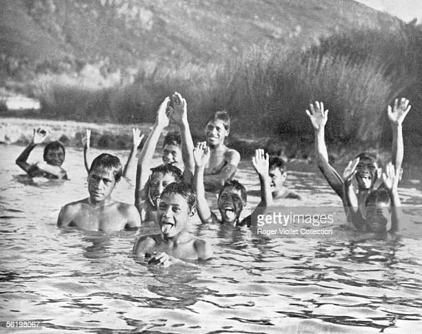 New Zealand Young maori going for money thrown in water by the tourists with Ohinemutu About 1920
