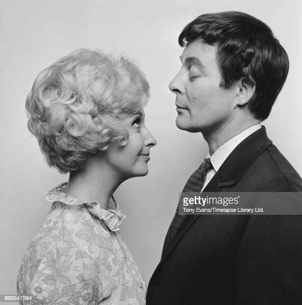 New Zealandborn British actress Nyree Dawn Porter and British actor Paul Daneman starring in the sitcom 'Never a Cross Word' 1968