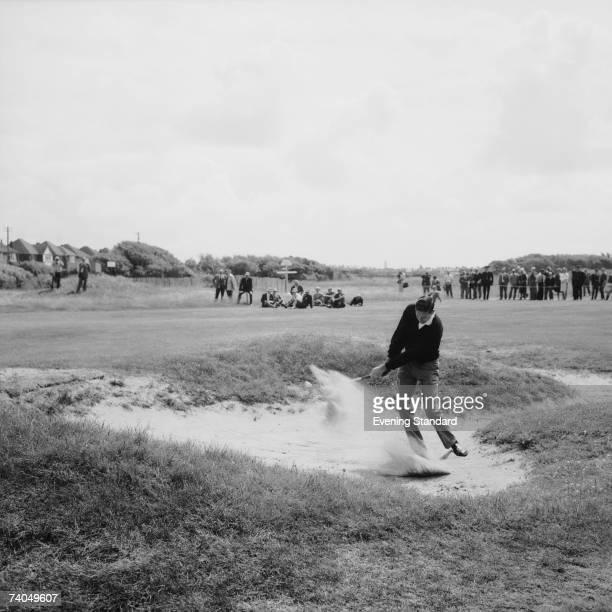 New Zealandborn golfing champion Bob Charles drives from the bunker during the British Open Golf Championship at Royal Lytham St Annes Golf Club July...